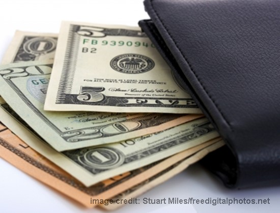 US dollar cash from a black wallet